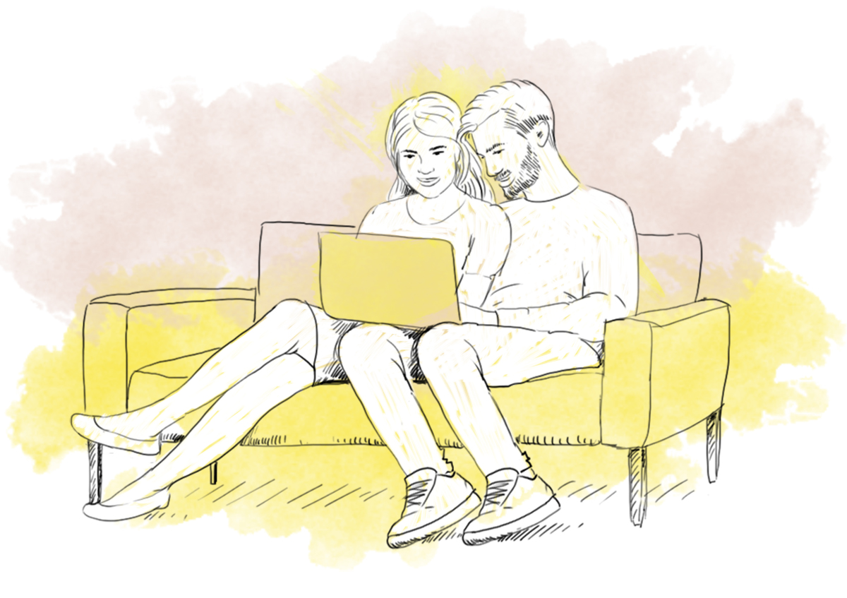 A couple sitting on a sofa with a laptop - online couples therapy